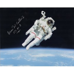 STS 41b Bruce McCandless floating in space.